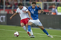 October 14, 2018 - Chorzow, Poland - Bartiosz Bereszynski of Poland and Federico Chiesa of Italy during the UEFA Nations League A match between Poland and Italy at Silesian Stadium in Chorzow, Poland on October 14, 2018  (Credit Image: © Andrew Surma/NurPhoto via ZUMA Press)