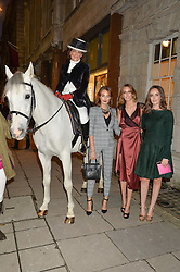 The DUCHESS OF RUTLAND with her daughters, left to right, LADY VIOLET MANNERS, LADY ALICE MANNERS and LADY ELIZA MANNERS at a party to celebrate the publication of Capability Brown & Belvoir - Discovering a lost Landscape by The Duchess of Rutland, held at Christie's, 8 King Street, St.James, London on 7th October 2015.