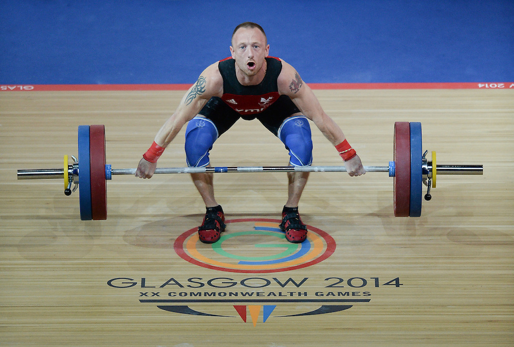 Photographer Ian Cook/CameraSport<br /> <br /> 20th Commonwealth Games - Weightlifting - Men's 62Kg -  Day 2 - Friday 25th July 2014 - Glasgow - UK<br /> <br /> © CameraSport - 43 Linden Ave. Countesthorpe. Leicester. England. LE8 5PG - Tel: +44 (0) 116 277 4147 - admin@camerasport.com - www.camerasport.com