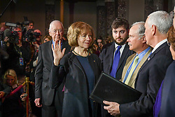 January 3, 2018 - Washington, DC, USA - Senator Tina Smith is sworn in by Vice President Mike Pence in a ceremonial swearing in ceremony Wdnesday, Jan. 3, 2018 in Washington,D.C.  On the left is her father Harlan Flint, on the right her son Samuel and her husband Archie. (Credit Image: © Glen Stubbe/TNS via ZUMA Wire)