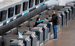 Passenger checking in at quiet check in desks operated by Ryanair at Prestwick Airport in Ayrshire, Scotland, UK