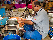 08 SETEMBER 2018 - BANGKOK, THAILAND:  A craftsman makes a statue of a mouse that will go on a Ganesh statue at Wat Witsanu Hindu Temple, also called the Vishnu Temple, in Bangkok. Indian craftsmen are making statues of the Hindu deity Ganesha for the Ganesh Chaturthi, or Ganesh Festival, held at Hindu temples in September. All of the craftsmen, and the clay they use to fashion the statues, come from India every year to make the statues. Although Thais are predominantly Buddhist, the Lord Ganesh, the Hindu overcomer of obstacles, is worshipped by many Thais and Ganesh Chaturthi is celebrated in many Thai communities.        PHOTO BY JACK KURTZ