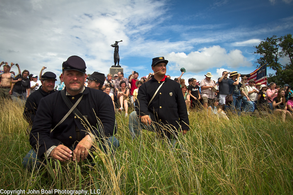 From left, Chuck Patz, of New Florence, Pennsylvania, Rex Lichtenfels, of New Florence, PA, Wendi Dowler, of Latrobe, PA and David Kukura, of Black Lick, PA await the arrival of the Confederate living historians and participants at the conclusion of the Pickett's Charge Commemorative March, in front of the 72nd Pennsylvania Infantry Monument, during the Sesquicentennial Anniversary of the Battle of Gettysburg, Pennsylvania on Wednesday, July 3, 2013.  The march was an opportunity to follow in the footsteps of Confederate soldiers by walking with living historians and park rangers along the path of the famously ill-fated Pickett's Charge, which brought to a close The Battle of Gettysburg when the Union Army repelled their advance. The Battle of Gettysburg lasted from July 1-3, 1863 resulting in over 50,000 soldiers killed, wounded or missing.  John Boal Photography
