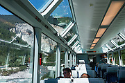 "Ruinaulta (or Rheinschlucht, the Rhine Gorge of Switzerland, or Swiss Grand Canyon) was created by the Anterior Rhine between Ilanz/Glion and Reichenau, in the debris of the Flims Rockslide, in eastern Switzerland, the Alps, Europe. Panorama cars of the Glacier Express train, operated jointly by the Matterhorn Gotthard Bahn (MGB) and Rhaetian Railway (RhB), provide views through the Rhine Gorge. Its local name Ruinaulta means ""high heap of rubble"", referring to the bizarre whitish rock formations, debris from a prehistoric rockslide that 10,000 years ago blocked the Rhine (near Flims) after the retreat of the Ice Age valley glacier. Since then, river erosion has cut an impressive gorge. Protected by cliffs several hundred meters high, the forested area is a haven for wildlife. This stretch of the river, now popular for rafting, was largely inaccessible until the Chur-Ilanz section of Rhaetian Railway, or Rhätische Bahn (RhB), opened in 1903. In 2008, the ""Rhaetian Railway in the Albula/Bernina Landscapes"" (the part from Thusis to Tirano, including St Moritz) was honored as a UNESCO World Heritage Site. Rheinschlucht is just upstream of the Anterior Rhine's confluence with the Posterior Rhine at Reichenau in the Grisons/Graubünden/Grigioni/Grischun canton of Switzerland."