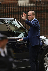The Duke of Cambridge waves to the crowd after leaving with his newborn son outside the Lindo Wing at St Mary's Hospital in Paddington, London.