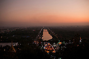 Skyline view at sunset from Mandalay Hill, Mandalay, Burma.<br />