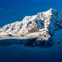 Kwangde Peak rises above fog in the Khumbu region of Nepal 1986.