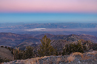 A soft pink glow hangs in the east as seen from Telescope Peak, the top of Death Valley National Park. The views from this 11,049 feet high mountain are outstanding. Nowhere else can you see both the highest and the lowest point in the continental US. On the upper slopes of the Panamint Range grow bristlecone pines, a tree with a lifespan measured in millennia. The pink glow in the sky is known as the Belt of Venus, and it's caused by the backscattering of reddened light from the setting sun. The blue band beneath it is the shadow of the earth projected out onto the earth's atmosphere. If I had taken a panorama you could see that this shadow is curved, matching the curvature of the earth. This phenomena can be seen on any clear evening in the east after the sun sets (or in the west before the sun rises). But the colors were especially vivid here, above all the dust and aerosols in the lower atmosphere. I wanted to stay on the summit to watch the stars come out, but I still had to hike 8 miles and descend 3600 feet to get back to the Thorndike Campground where I started.