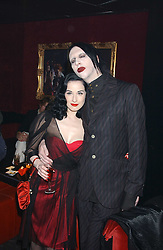 MARILYN MANSON and DITA VON TEESE at a party to celebrate the first issue of British Harper's Bazaar held at Cirque, 10-14 Cranbourne Street, London WC2 on 16th February 2006.<br />