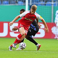 13.09.2020, Carl-Benz-Stadion, Mannheim, GER, DFB-Pokal, 1. Runde, SV Waldhof Mannheim vs. SC Freiburg, <br /> <br /> DFL REGULATIONS PROHIBIT ANY USE OF PHOTOGRAPHS AS IMAGE SEQUENCES AND/OR QUASI-VIDEO.<br /> <br /> im Bild: Yannik Keitel (SC Freiburg #36) gegen Anton Donkor (SV Waldhof Mannheim #19)<br /> <br /> Foto © nordphoto / Fabisch