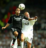 Photo Aidan Ellis.<br />Leeds United v Newcastle United (FA Barclaycard Premiership) 17/08/2003.<br />Newcastle's Kieron Dyer and Leeds Seth Johnson