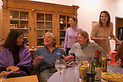 At a dinner party at the Reykjavik, Iceland, home of Thordis (with plate at right), Keith Bellows yaks it up with guests. On left is Keith's wife Melina, standing is Annie Griffiths-Belt, and seated center is Linnea Cahill, Tim Cahill's wife..