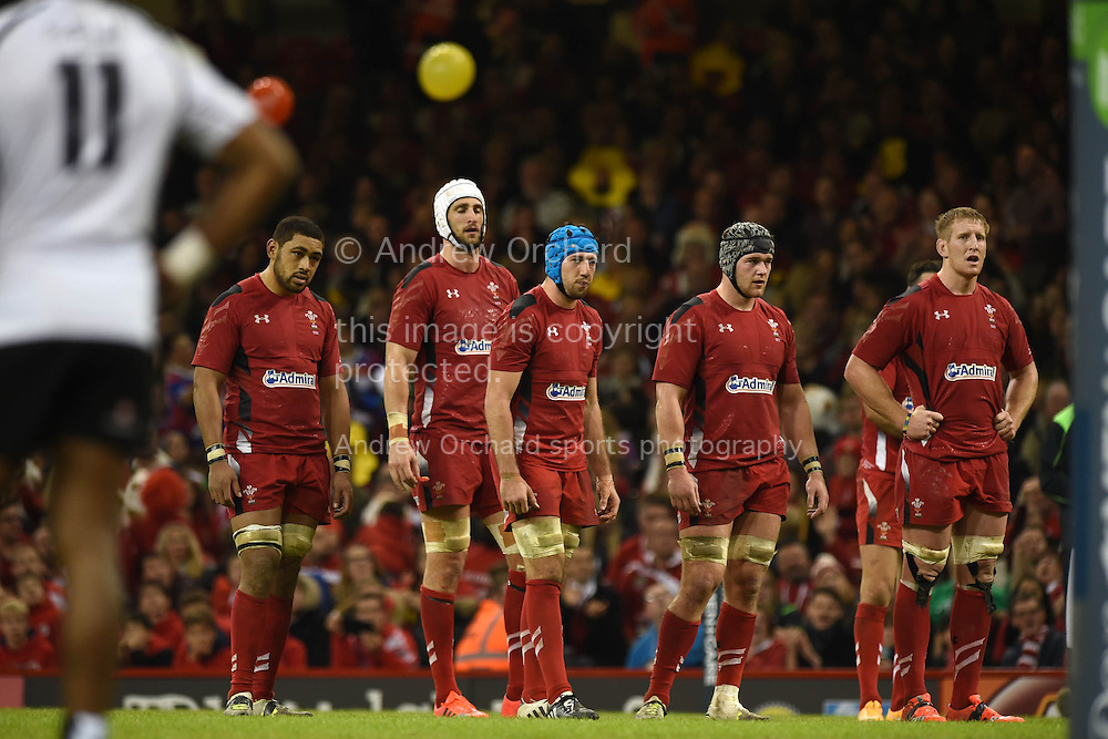 The Welsh forwards look on. Dove Men series 2014, autumn international rugby, Wales v Fiji at the Millennium Stadium in Cardiff, South Wales on Saturday 15th November 2014.<br /> pic by Andrew Orchard, Andrew Orchard sports photography.