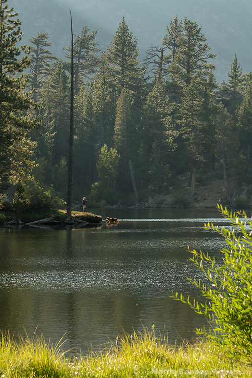 Woman with her dog at Lane Lake, Hoover Wilderness, Humbolt-Toiyabe National Forest, California