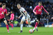 West Brom's James McLean (c) goes past Peterborough's Harry Beautyman (r). The Emirates FA Cup, 4th round match, West Bromwich Albion v Peterborough Utd at the Hawthorns stadium in West Bromwich, Midlands on Saturday 30th January 2016. pic by Carl Robertson, Andrew Orchard sports photography.