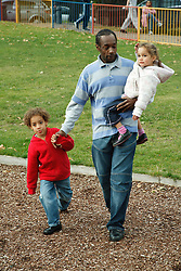 Man with children in playground