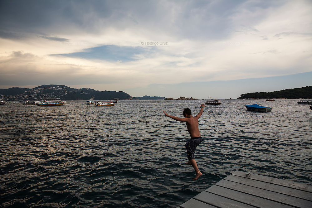ACAPULCO, MEXICO - AUGUST 5, 2015: A boy jumps to the sea in Acapulco, Mexico.  Rodrigo Cruz for The New York Times