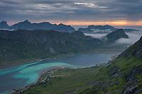 View over colorful water of Skjelfjord, Flakstadøy, Lofoten Islands, Norway
