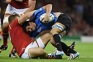 Jorge Zerbino is tackled by Tomas Francis of Wales. Rugby World Cup 2015 pool A match, Wales v Uruguay at the Millennium Stadium in Cardiff, South Wales  on Sunday 20th September 2015.<br /> pic by  Andrew Orchard, Andrew Orchard sports photography.
