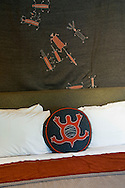 Bed pillow and native american style decor in rustic cedar cabin, El Capitan Canyon Resort, near Santa Barbara, California