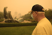 Man checking out the scene at the Oregon State Capitol under the smoke from the 2020 Oregon wildfires.