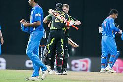 © Licensed to London News Pictures. 28/09/2012. Australians David Warner & Glenn Maxwell hug in celebration after beating India during the T20 Cricket World cup match between Australia Vs India at the R.Premadasa Cricket Stadium,Colombo. Photo credit : Asanka Brendon Ratnayake/LNP