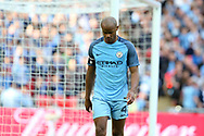 Manchester city captain Vincent Kompany looks on dejected.  The Emirates FA Cup semi-final match, Arsenal v Manchester city at Wembley Stadium in London on Sunday 23rd April 2017.<br /> pic by Andrew Orchard,  Andrew Orchard sports photography.