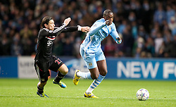 07.12.2011, City of Manchester Stadion, Manchester, ENG, UEFA CL, Gruppe A, Manchester City (ENG) vs FC Bayern München (GER), im Bild Manchester City's Yaya Toure in action against FC Bayern Munchen's Danijel Pranjic during the football match of UEFA Champions league, group A, between Manchester City (ENG) and FC Bayern München (GER), at City of Manchester Stadium, Manchester, United Kingdom on 07/12/201. EXPA Pictures © 2011, PhotoCredit: EXPA/ Propaganda/ David Rawcliff..***** ATTENTION - OUT OF ENG, GBR, UK *****