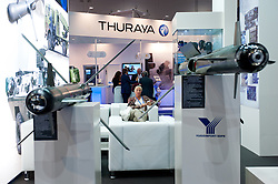 DSEI arms fair in London.<br /> A woman sits on a chair at the Thuraya stand during the 2013 edition of DSEI at Excel London, United Kingdom. Tuesday, 10th September 2013. Picture by Piero Cruciatti / i-Images