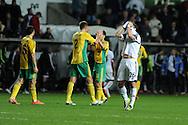 Swansea city 's Alvaro Vazquez shows his frustration as Kuban Krasnodar players celebrate after drawing match 1-1.  UEFA Europa league match, Swansea city v FC Kuban Krasnodar at the Liberty Stadium in Swansea, South Wales on Thursday 24th October 2013.