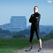 An athlete with a prosthetic leg shot against the Basingstoke skyline.