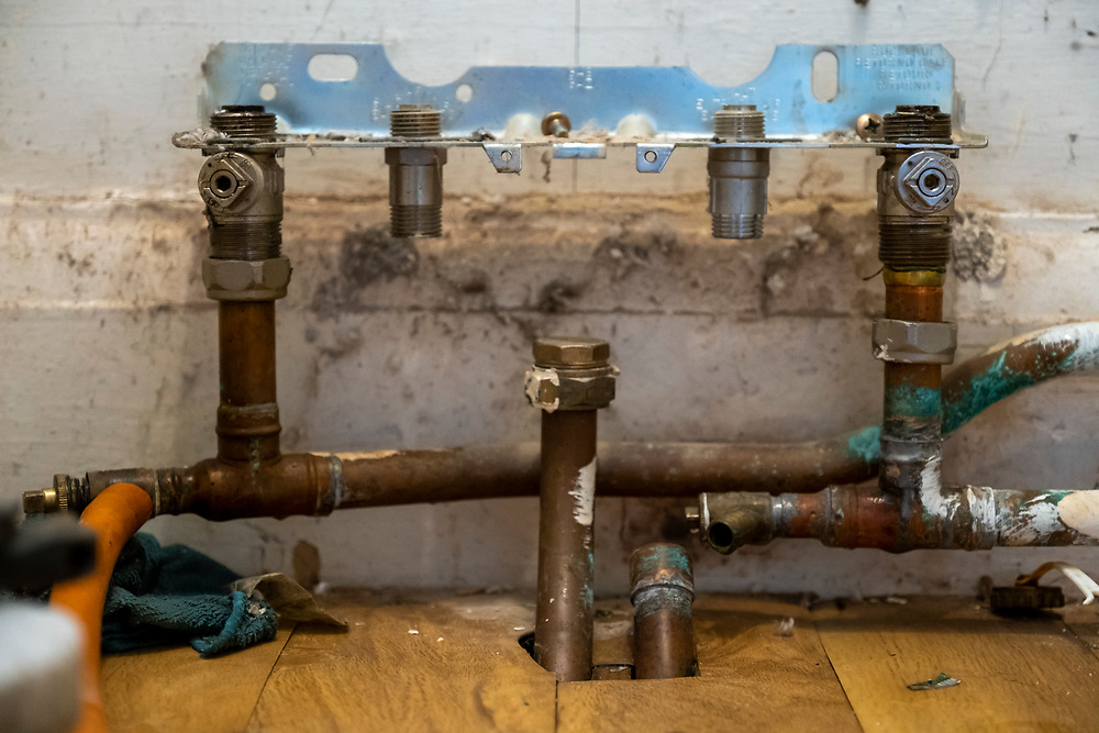 The remains of a gas boiler that has been removed from a property to be replaced with an air source heat pump in Folkestone, United Kingdom on the 20th of September 2021.  With gas prices increasing and the increasing need to reduce fossil fuel air source heat pumps are slowly starting to replace the gas boiler use in properties in the UK. (photo by Andrew Aitchison / In pictures via Getty Images)