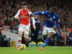 Arsenal's Hector Bellerin attacks down the wing under pressure from Leicester City's Jeffrey Schlupp - Photo mandatory by-line: Alex James/JMP - Mobile: 07966 386802 - 10/02/2015 - SPORT - Football - London - Emirates Stadium - Arsenal v Leicester City - Barclays Premier League