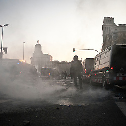 Police take over this corner and the fires are extinguished. The riots continued on into the night in other areas of the city.