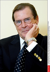 © Greg Soussan/ABACA. 42159-1. UNICEF Goodwill Ambassador Roger Moore pose for our photographer at the George V Four Seasons hotel. He is in Paris to tape the tv show Absolument 70 (Absolutely 70's) for the M6 tv channel.