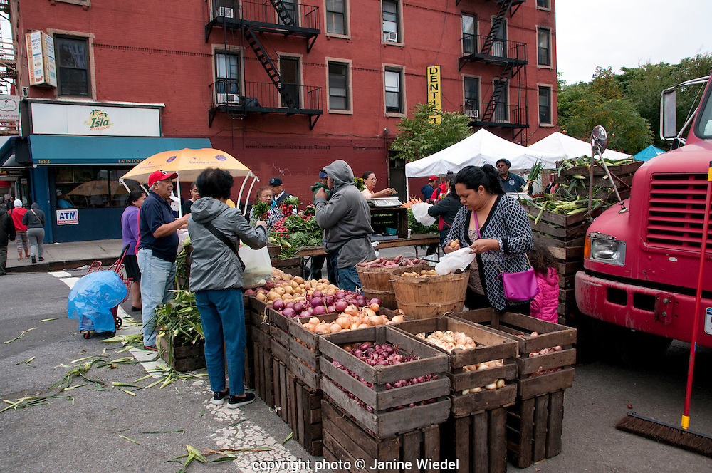 Outdoor Fresh fruit and veg market produce in Harlem New York City