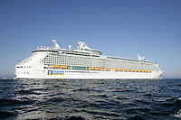 Royal Caribbean International's  Independence of the Seas, the world's largest cruise ship sails under the Storebelt Bridge in Denmark on her maiden voyage. The ship will call at Oslo before sailing to Southampton, UK where she will be based..The Storebelt bridge is Europe's longest span bridge.