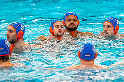 Guus van IJperen, Kjeld Veenhuis, Bilal Gbadamassi, Jesse Nispeling of the Netherlands in action against Montenegro during the Olympic qualifying tournament. The Dutch water polo players are on the hunt for a starting ticket for the Olympic Games on February 19, 2021 in Rotterdam