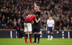 Manchester United's Ander Herrera appeals to match referee Mike Dean
