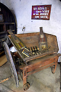 Un Repas san vins est une journee sans soleil (a meal without wine is like a day without sunshine). An old grape crushing machine. Chateau de Nouvelles. Fitou. Languedoc. The wine shop and tasting room. France. Europe.