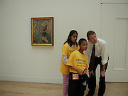 Mariya Bhukhun and Anton Peterson looking at Lucien Freud's most recent self portrait  with Nicholas Serota.. National Children's Art day. Tate. 13 June 2002. © Copyright Photograph by Dafydd Jones 66 Stockwell Park Rd. London SW9 0DA Tel 020 7733 0108 www.dafjones.com<br /><br />National children's Art day. Nicholas Serota with his shadows, Mariya Bhukhun and anton Peterson. © Copyright Photograph by Dafydd Jones 66 Stockwell Park Rd. London SW9 0DA Tel 020 7733 0108 www.dafjones.com
