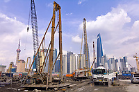 New construction along the Huangpu River with the skyscrapers of the Pudong side in the background, Shanghai, China