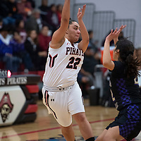 Lexi Garcia makes a pass across the court for the Grants Pirates Tuesday, Nov. 27 in a game against Kirtland Central at Grants High School.