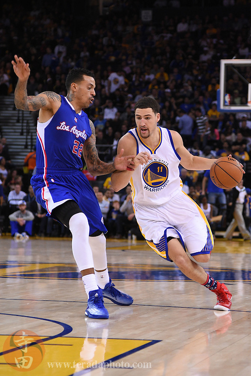 November 5, 2014; Oakland, CA, USA; Golden State Warriors guard Klay Thompson (11) dribbles the basketball against Los Angeles Clippers forward Matt Barnes (22) during the third quarter at Oracle Arena. The Warriors defeated the Clippers 121-104.