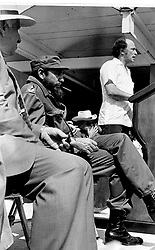 Premier Fidel Castro of Cuba looks pensive as he smokes his cigar while Prime Minister Trudeau of Canada talks to a crowd of 20, 000 Cubans in the city in Cienfuegos Jan. 28, 1976. Photo by Fred Chartrand/CP/ABACAPRESS.COM