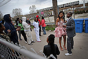 Te'airah Gaylord and Raymond Solomon depart their prom send-off party Friday, May 2, 2014 in an Austin backyard. Te'airah, 17, is a senior at Notre Dame High School for Girls and the celebration was at her grandmother and great-grandmother's home. (Brian Cassella/Chicago Tribune) B583688985Z.1 <br /> ....OUTSIDE TRIBUNE CO.- NO MAGS,  NO SALES, NO INTERNET, NO TV, CHICAGO OUT, NO DIGITAL MANIPULATION...
