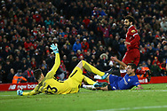 Mohamed Salah of Liverpool places the ball past Chelsea Goalkeeper Thibaut Courtois and scores his teams 1st goal. Premier League match, Liverpool v Chelsea at the Anfield stadium in Liverpool, Merseyside on Saturday 25th November 2017.<br /> pic by Chris Stading, Andrew Orchard sports photography.