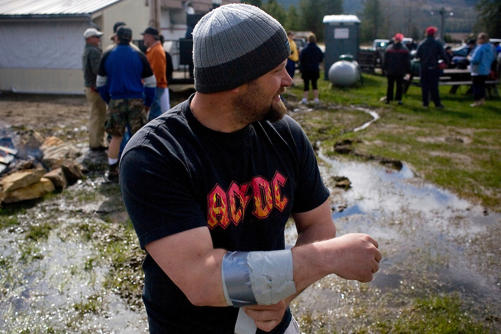 A participant wraps his injured arm at the 2011 Mud Volleyball Tournament in Laclede, ID sponsored by the Kodiak Bar. .(©Matt Mills McKnight/2011)