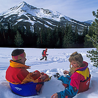 A couple enjoys a picnic during a break from skiing at Montana's Big Sky Resort.