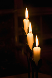 Close-up of three burning candles, Bavaria, Germany